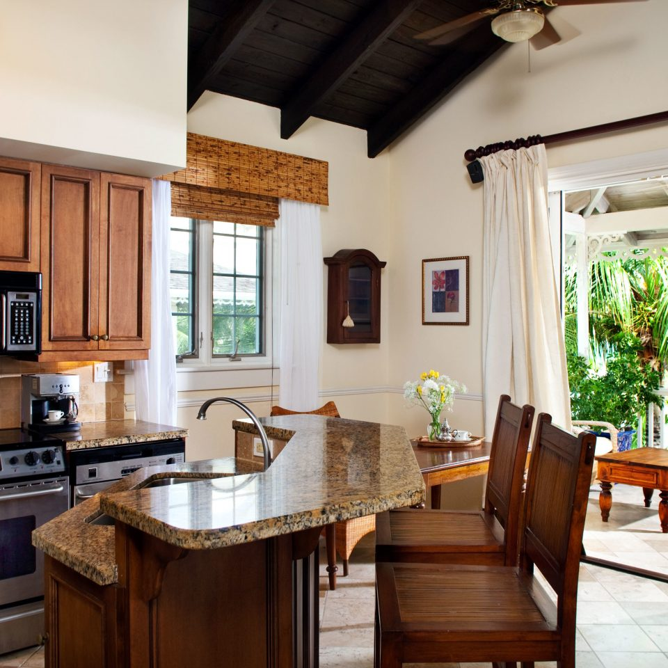 Beachfront Drink Eat Family Kitchen Luxury Resort cabinet property home house hardwood cottage cuisine classique living room farmhouse wooden cabinetry mansion Villa