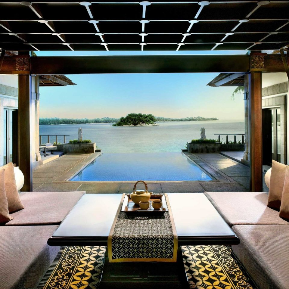 Beachfront Drink Eat Lounge Scenic views property condominium home living room lighting yacht vehicle Villa swimming pool Resort