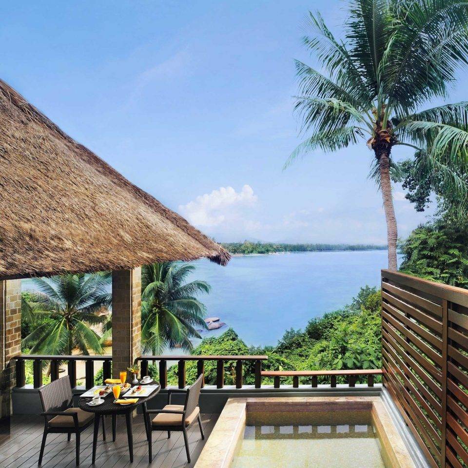 Beachfront Drink Eat Lounge Scenic views tree sky ground property Resort Villa walkway swimming pool arecales roof shade
