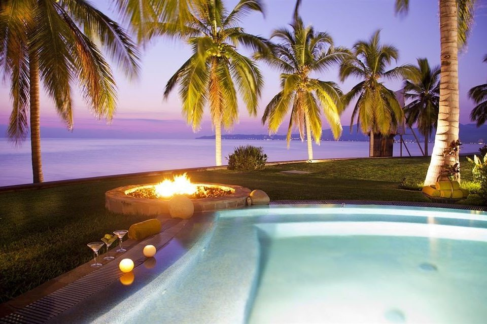 Beachfront Drink Honeymoon Hot tub/Jacuzzi Ocean Outdoor Activities Outdoors Patio Pool Romance Romantic Sunset Tropical tree palm swimming pool Resort arecales plant caribbean tropics lined