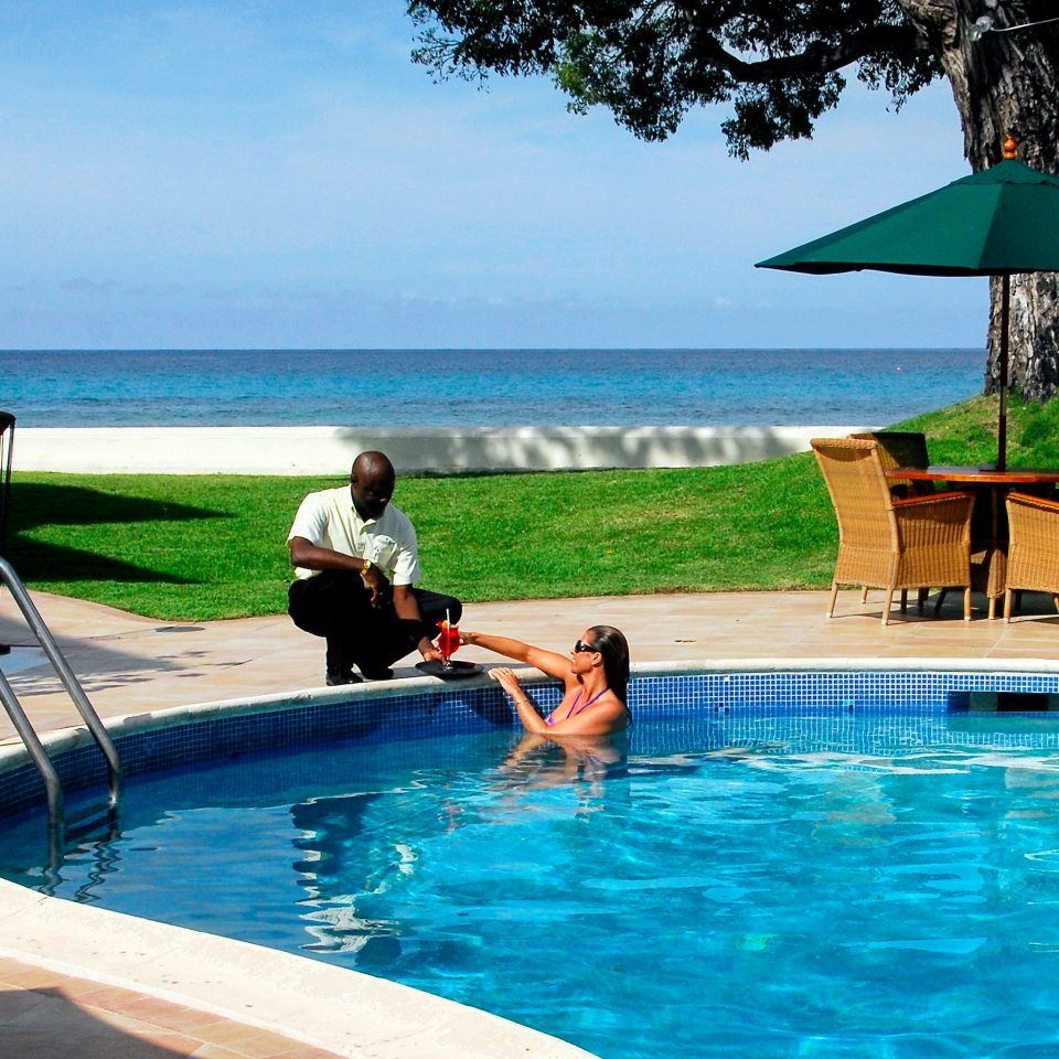 Beachfront Drink Outdoors Play Pool water sky swimming leisure swimming pool caribbean Resort water sport Sea blue Villa Lagoon pond drinking