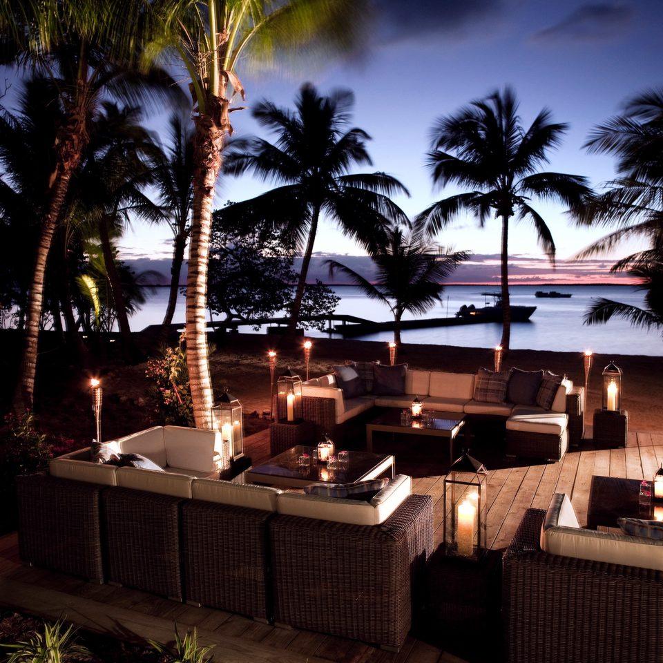 Beachfront Eco Lounge Luxury Resort Romance Scenic views tree night restaurant lighting evening landscape lighting arecales lit