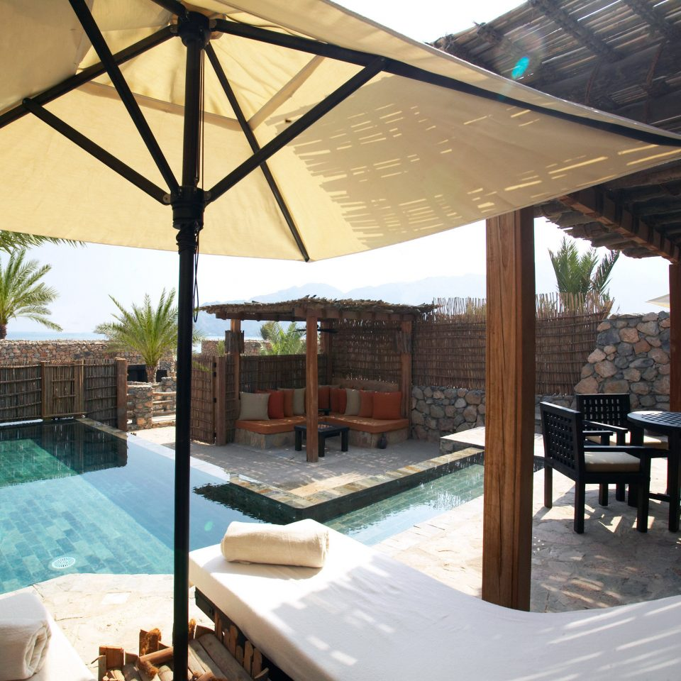 Beachfront Elegant Hip Luxury Modern Pool chair property swimming pool Resort Villa outdoor structure pergola backyard gazebo cottage shade