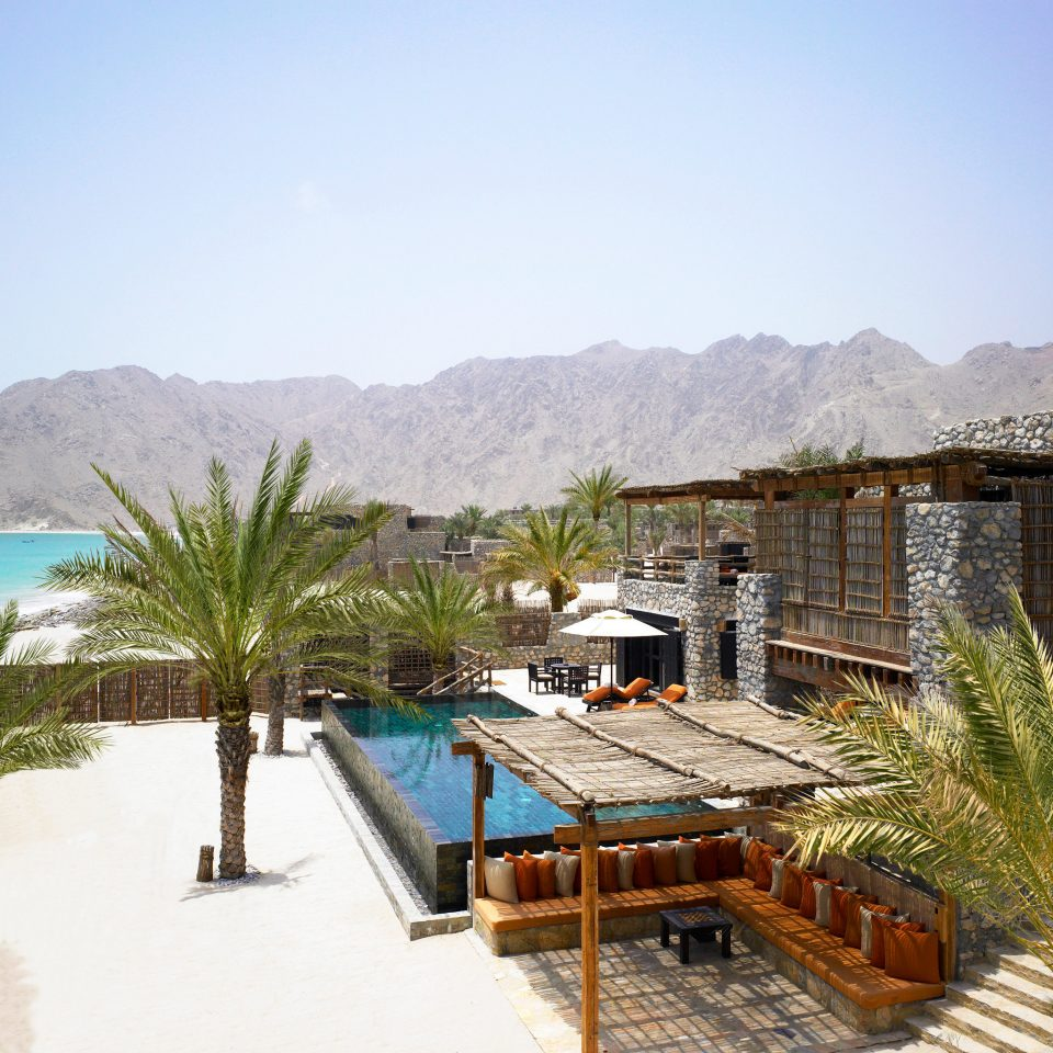 Beachfront Elegant Hip Luxury Modern Pool sky mountain property Resort swimming pool Nature Villa shore day