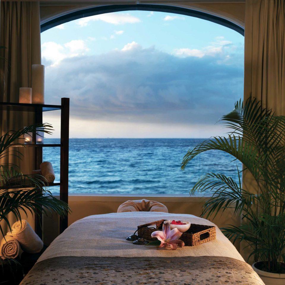 Beachfront Elegant Luxury Resort Spa Waterfront water house Ocean home Sea swimming pool overlooking arch