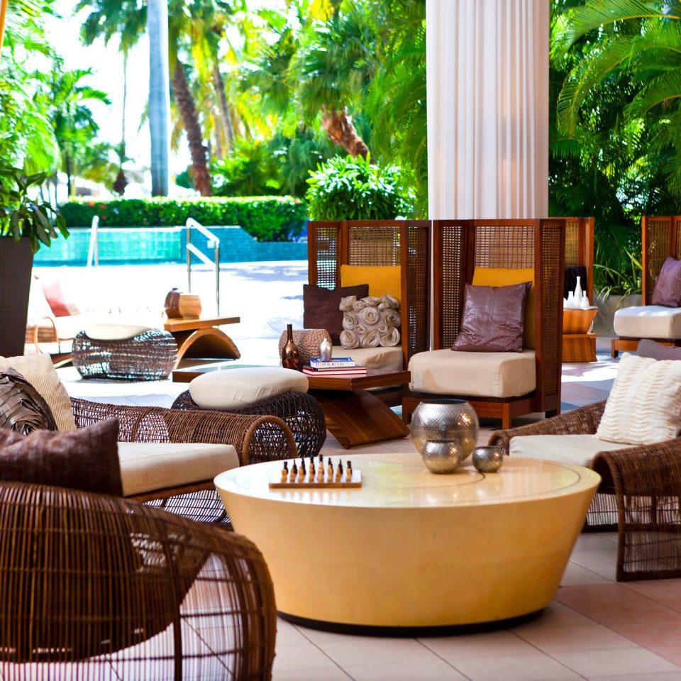 Beachfront Entertainment Lounge living room property home curtain porch condominium cottage Villa Resort backyard