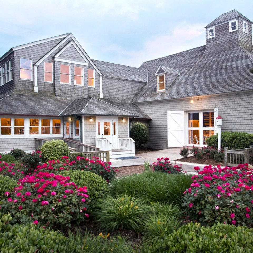 Beachfront Exterior Grounds Resort Trip Ideas Waterfront tree sky flower house property home building Garden cottage residential area yard lawn farmhouse backyard plant mansion manor house Villa landscaping bushes stone surrounded