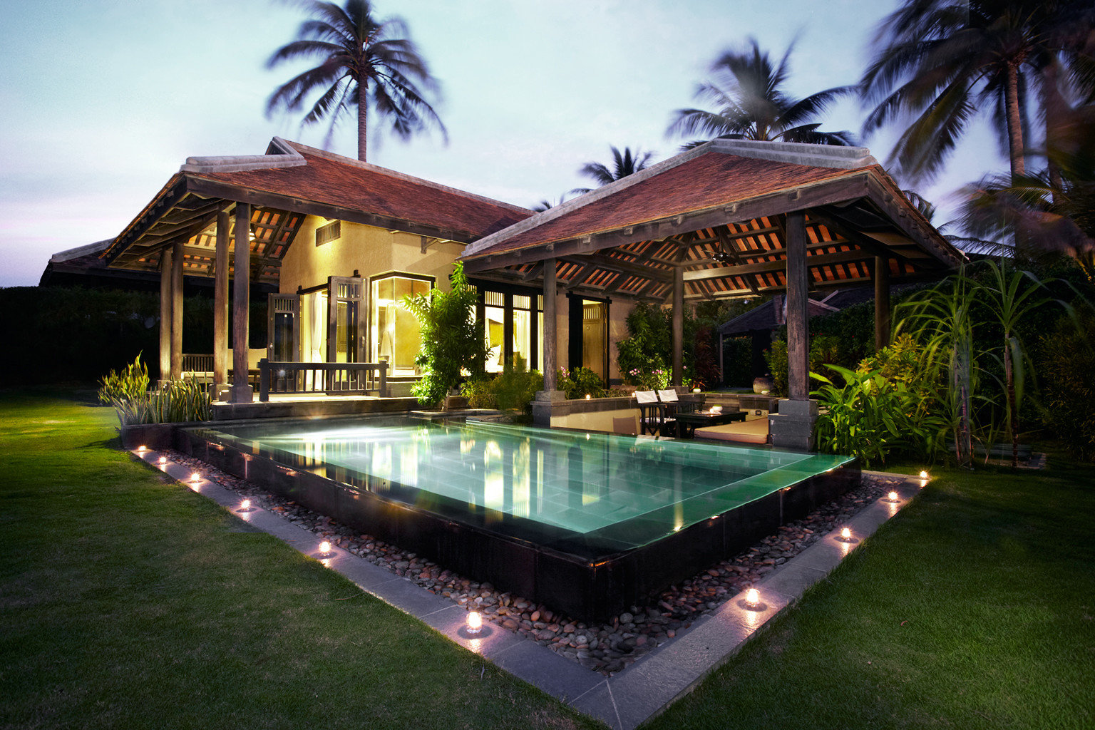 Beachfront Exterior Grounds Jungle Pool Resort Spa Tropical sky swimming pool property house building mansion home Villa backyard landscape lighting