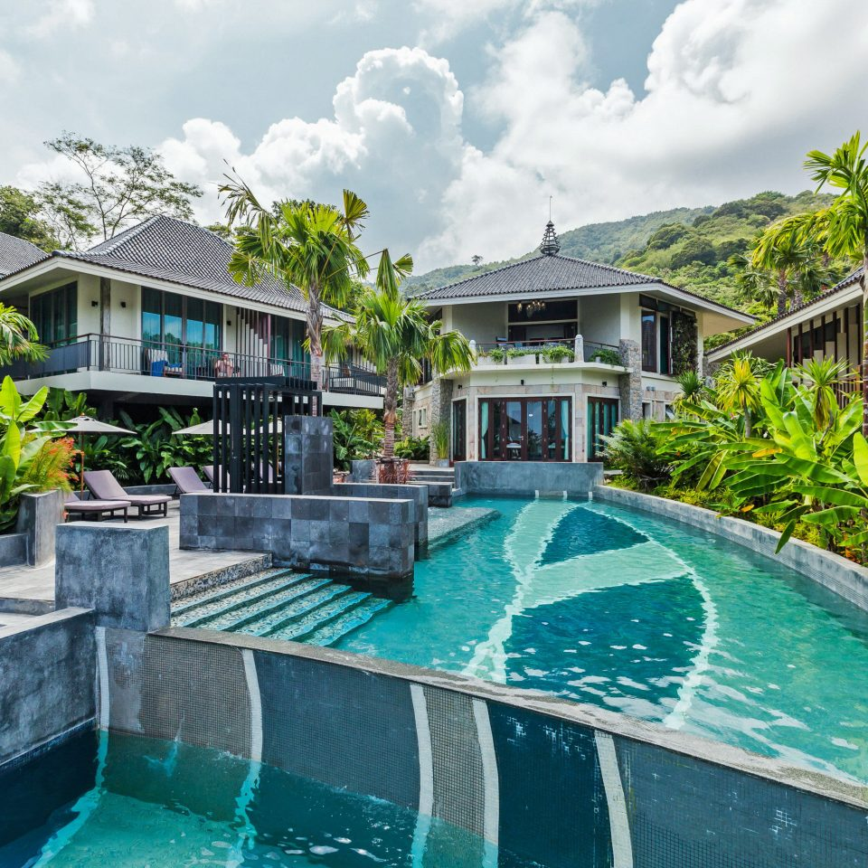 Beachfront Exterior Jungle Patio Pool Tropical swimming pool property leisure building Resort condominium house backyard home Villa mansion