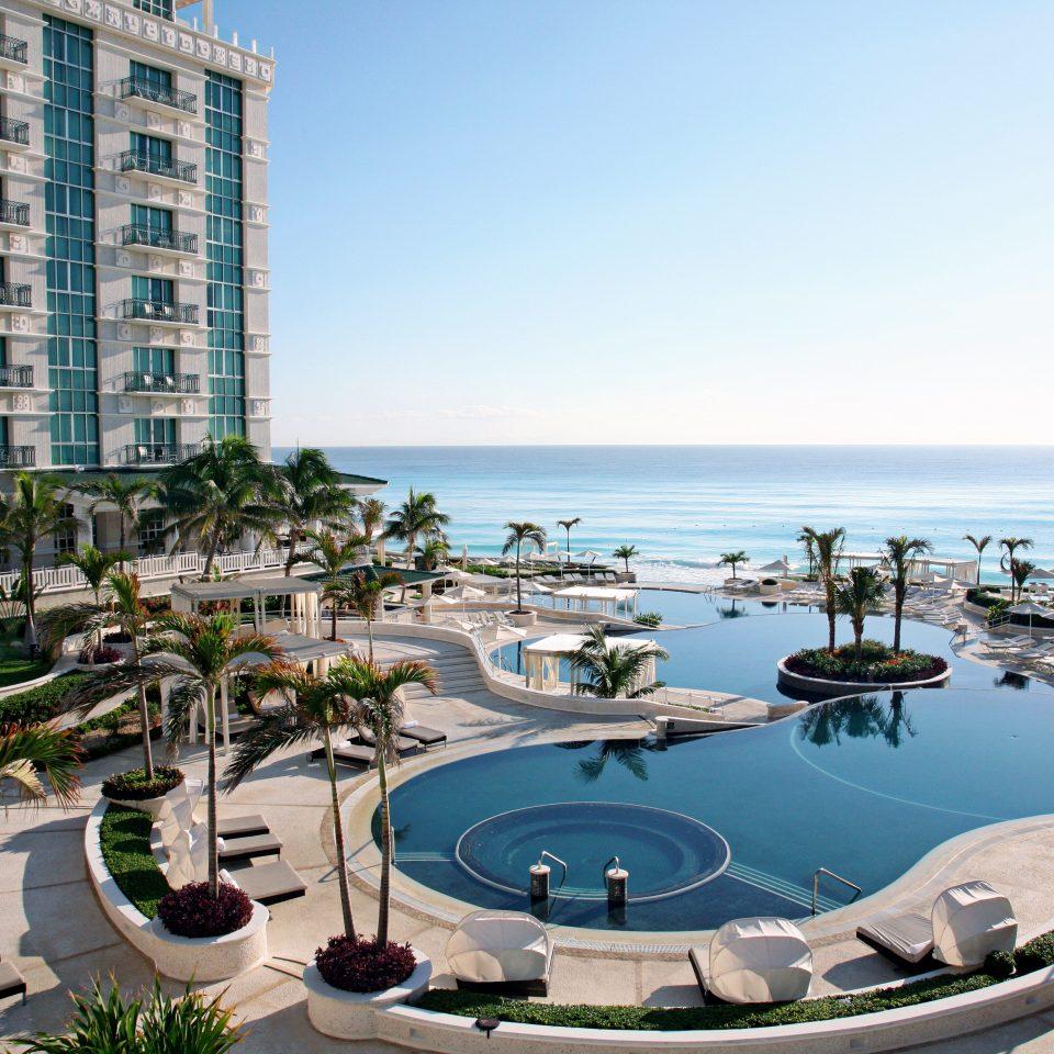 Beachfront Exterior Lounge Luxury Pool Romantic Trip Ideas sky condominium marina property leisure Resort dock residential area swimming pool Sea day