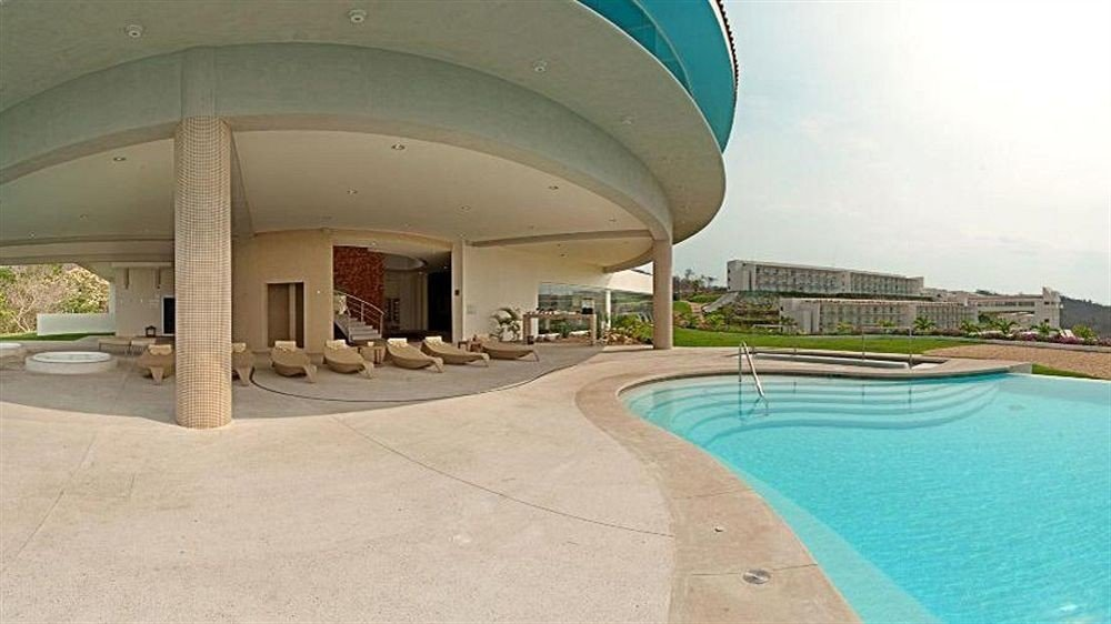 Beachfront Exterior Modern Pool Resort Waterfront swimming pool property leisure building Villa hacienda mansion colonnade