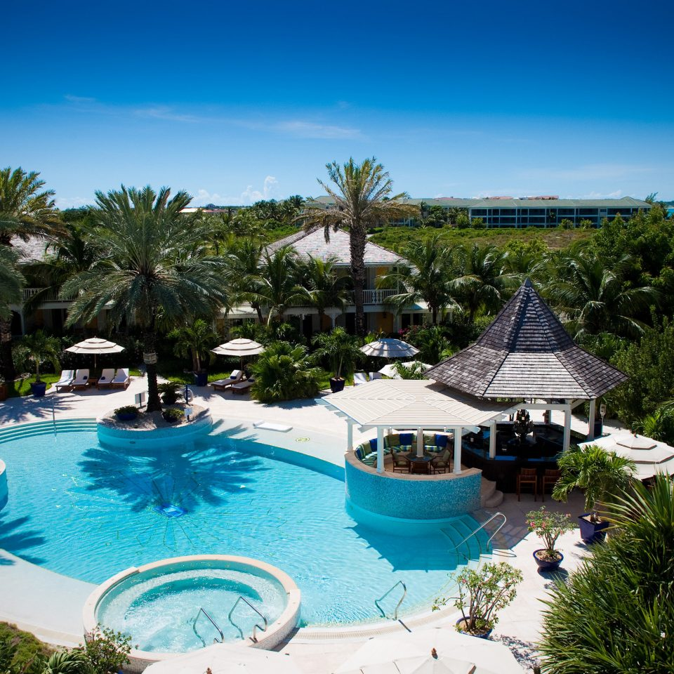 Beachfront Family Luxury Play Pool Resort Scenic views tree sky leisure swimming pool property blue lawn palm caribbean Villa resort town Water park Lagoon arecales condominium Garden lined plant swimming surrounded day