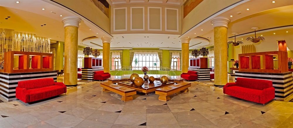 Beachfront Family Lobby Lounge Tropical yellow property building red Resort mansion palace living room recreation room Villa bright colored