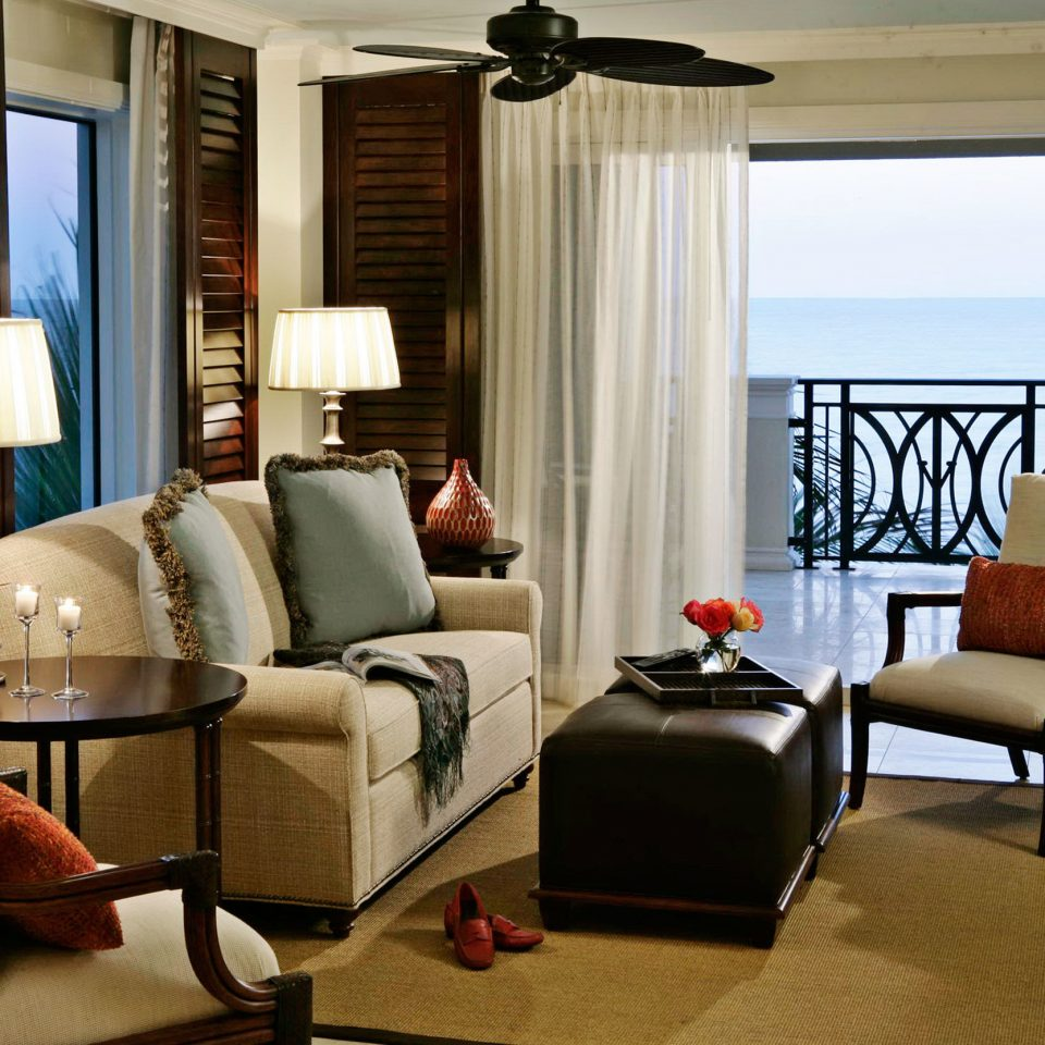 Beachfront Family Modern sofa chair living room property home Suite nice condominium cottage