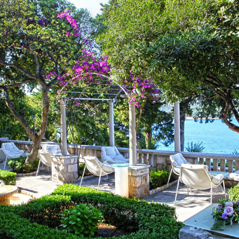 Beachfront Play Scenic views Trip Ideas Wellness tree property flower Resort Garden home backyard yard plant Villa cottage shade