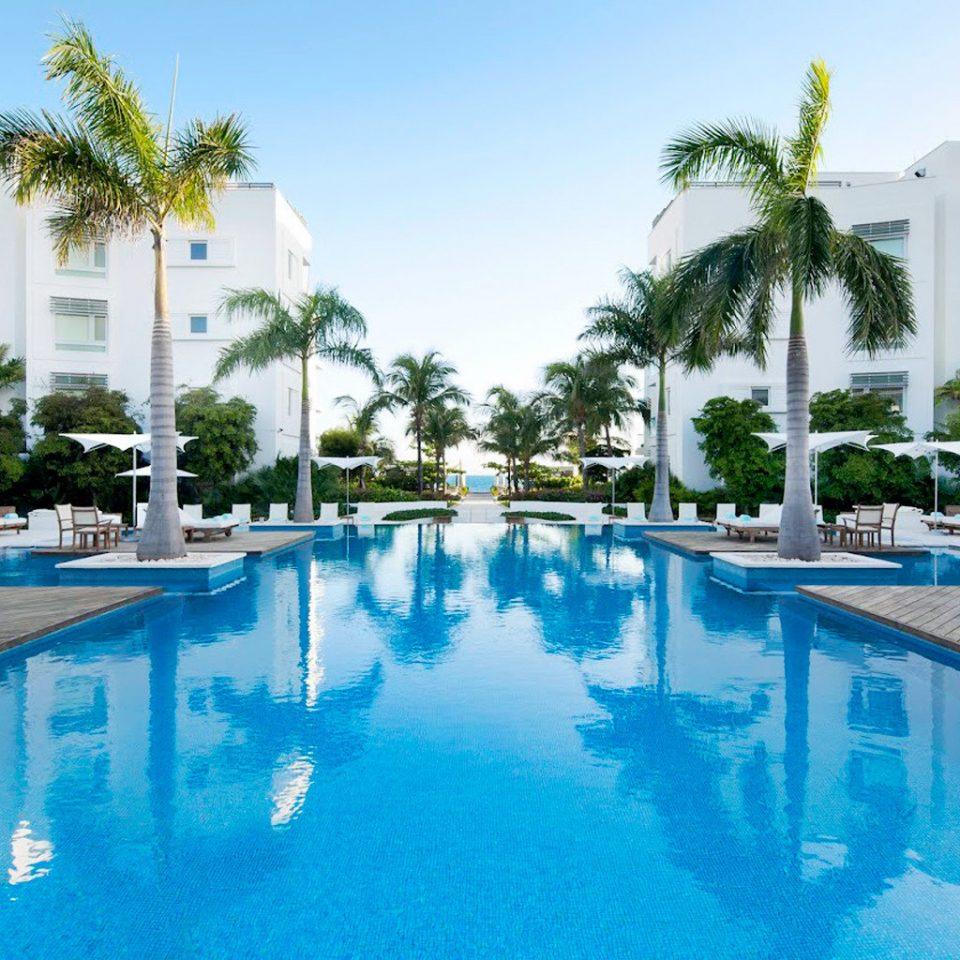 Beachfront Grounds Hotels Play Pool Resort Trip Ideas sky tree swimming pool property leisure condominium reflecting pool resort town Villa backyard blue swimming