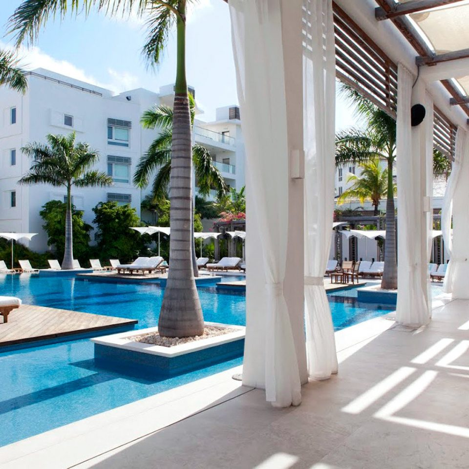 Beachfront Grounds Hotels Play Pool Resort Trip Ideas building property leisure condominium swimming pool Villa home mansion plaza colonnade
