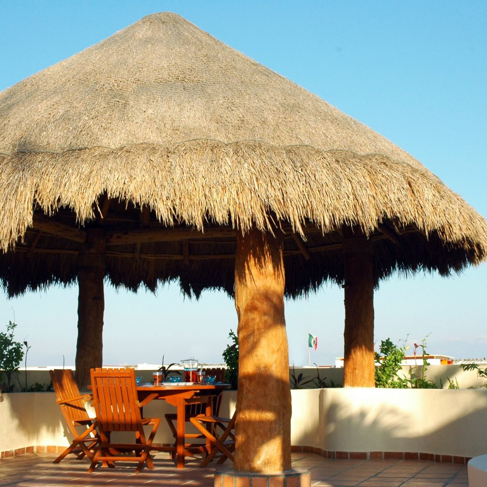 Beachfront Grounds Patio Waterfront sky hut Villa thatching Resort hacienda roof day
