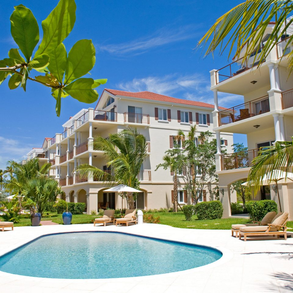 Beachfront Grounds Play Pool tree property swimming pool Resort condominium leisure home caribbean Villa mansion backyard eco hotel plant