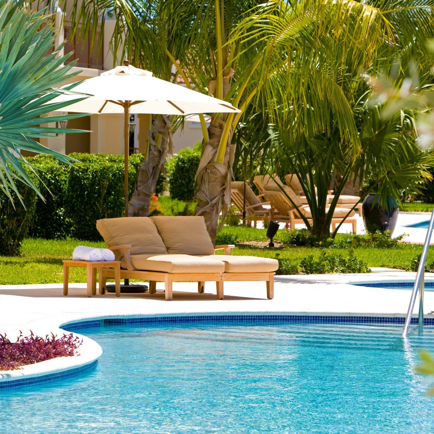 Beachfront Grounds Play Pool tree Resort swimming pool leisure property backyard Villa home condominium swimming palm