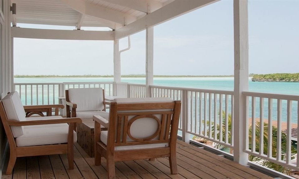 Beachfront Hip Lounge Luxury Tropical chair property building wooden cottage home Villa condominium porch Resort Suite