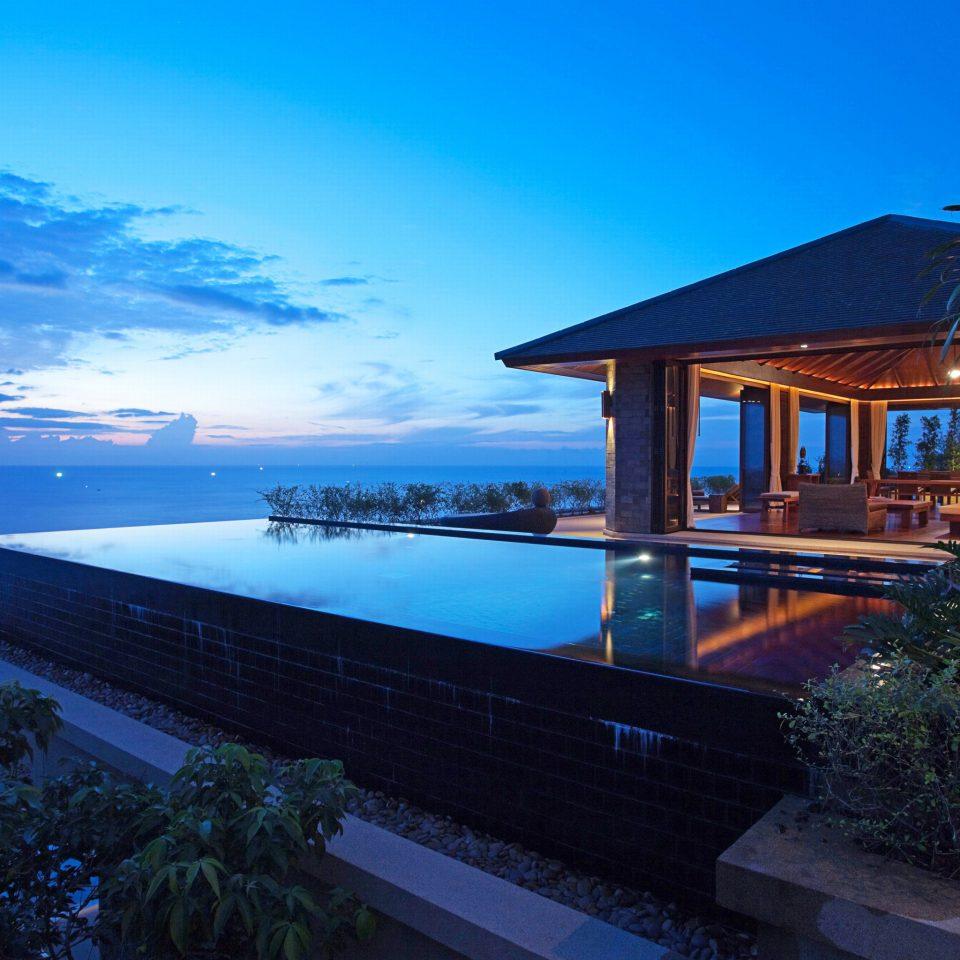 Beachfront Hip Luxury Modern Ocean sky tree property house Resort Sea home Villa caribbean overlooking