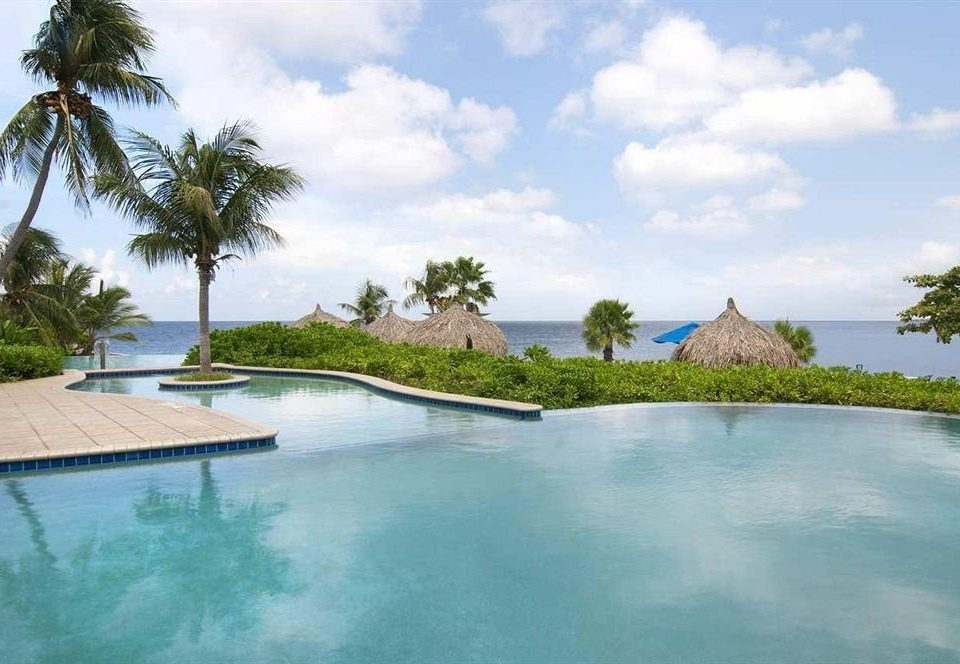 Beachfront Hot tub/Jacuzzi Luxury Pool Resort Scenic views Tropical sky tree water swimming pool property palm Nature Lagoon reef Villa caribbean Sea mansion shore surrounded
