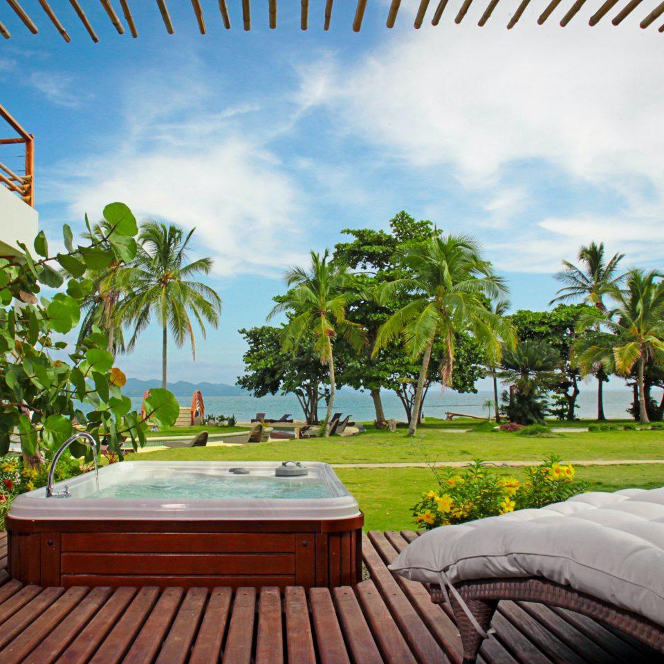 Beachfront Hot tub/Jacuzzi Patio Resort Scenic views tree leisure swimming pool caribbean arecales home condominium Villa