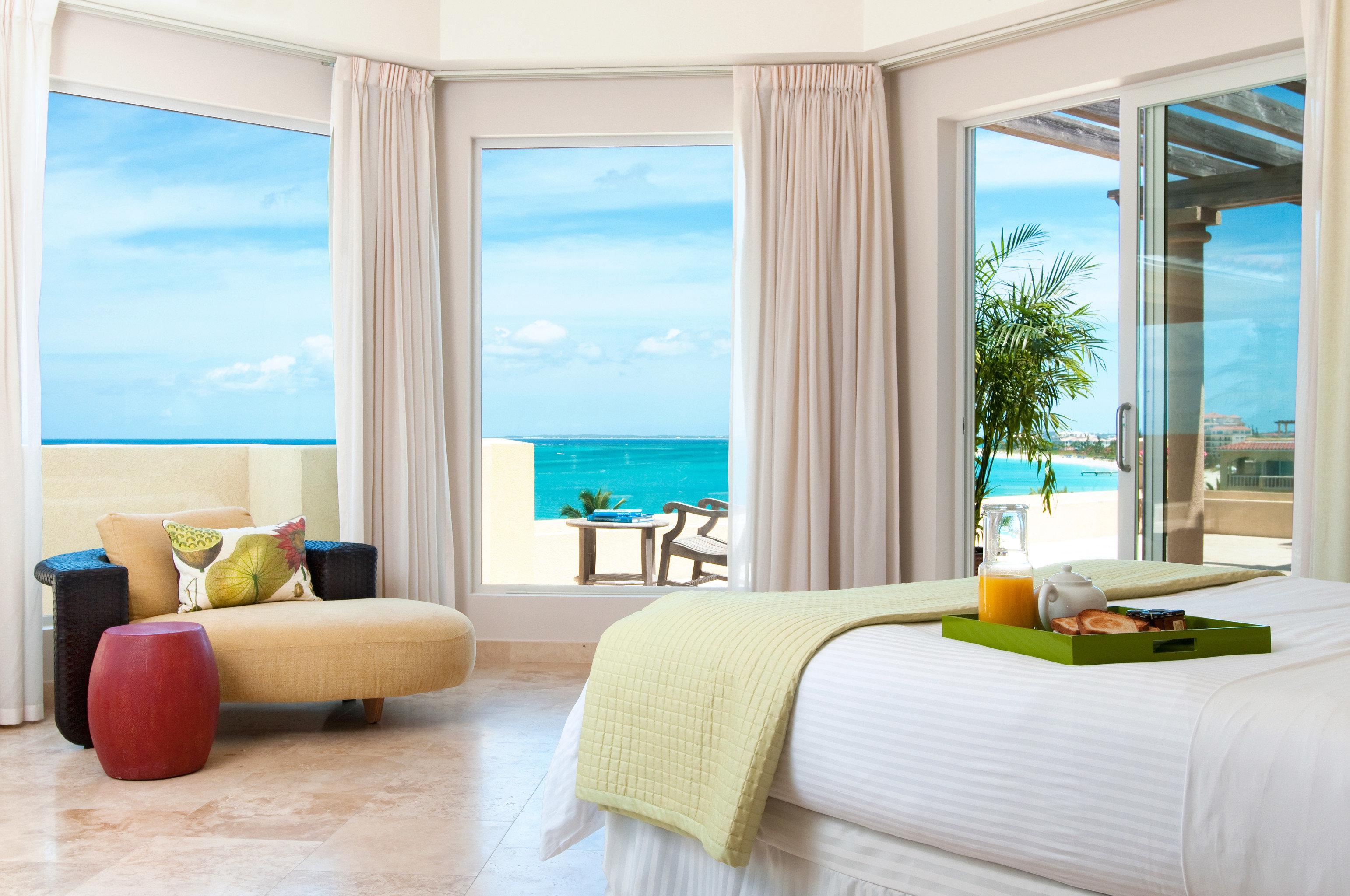 Beachfront Hotels Luxury Romance Scenic views sofa property living room nice condominium home Suite overlooking flat