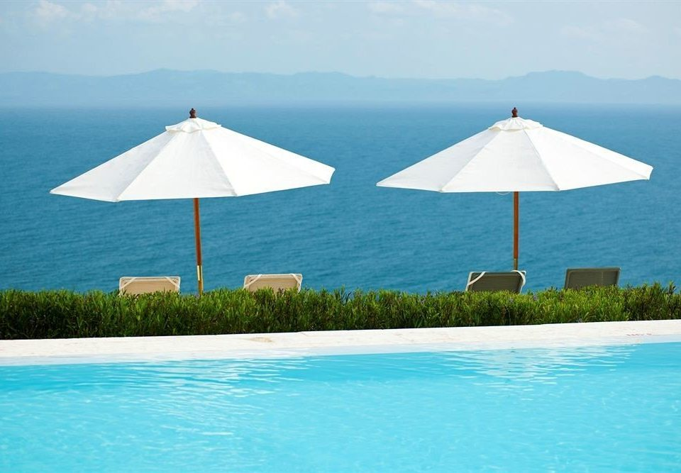 Beachfront Lounge Luxury Modern Ocean Pool Tropical water umbrella sky Nature swimming swimming pool blue Sea fashion accessory caribbean Lagoon Island lawn lined shore day