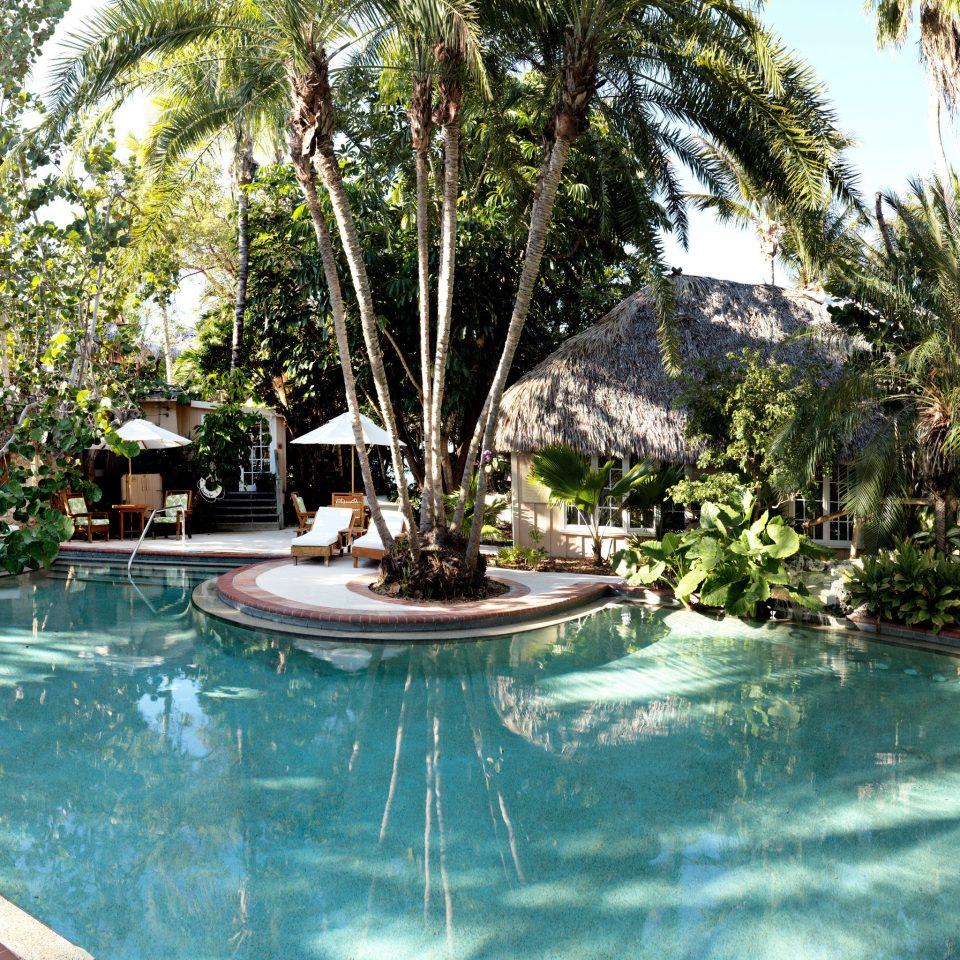 Beachfront Island Outdoors Pool Resort Romance Romantic Trip Ideas Waterfront tree swimming pool property leisure resort town Villa hacienda backyard eco hotel mansion plant
