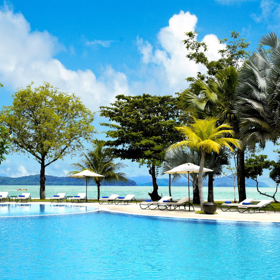 Beachfront Play Pool Resort Scenic views tree water sky swimming pool leisure arecales Ocean Sea caribbean blue Lagoon tropics swimming shore day