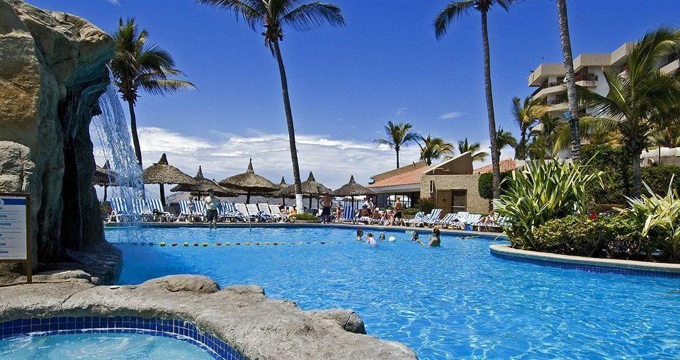 Beachfront Pool Resort tree water sky swimming pool leisure property caribbean resort town swimming Villa palm Water park Lagoon shade