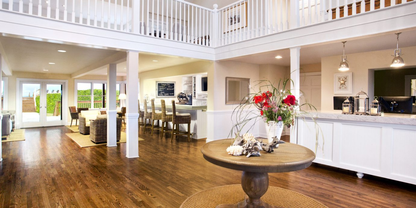 Beachfront Lobby Resort Waterfront building property living room home hardwood mansion wood flooring flooring condominium