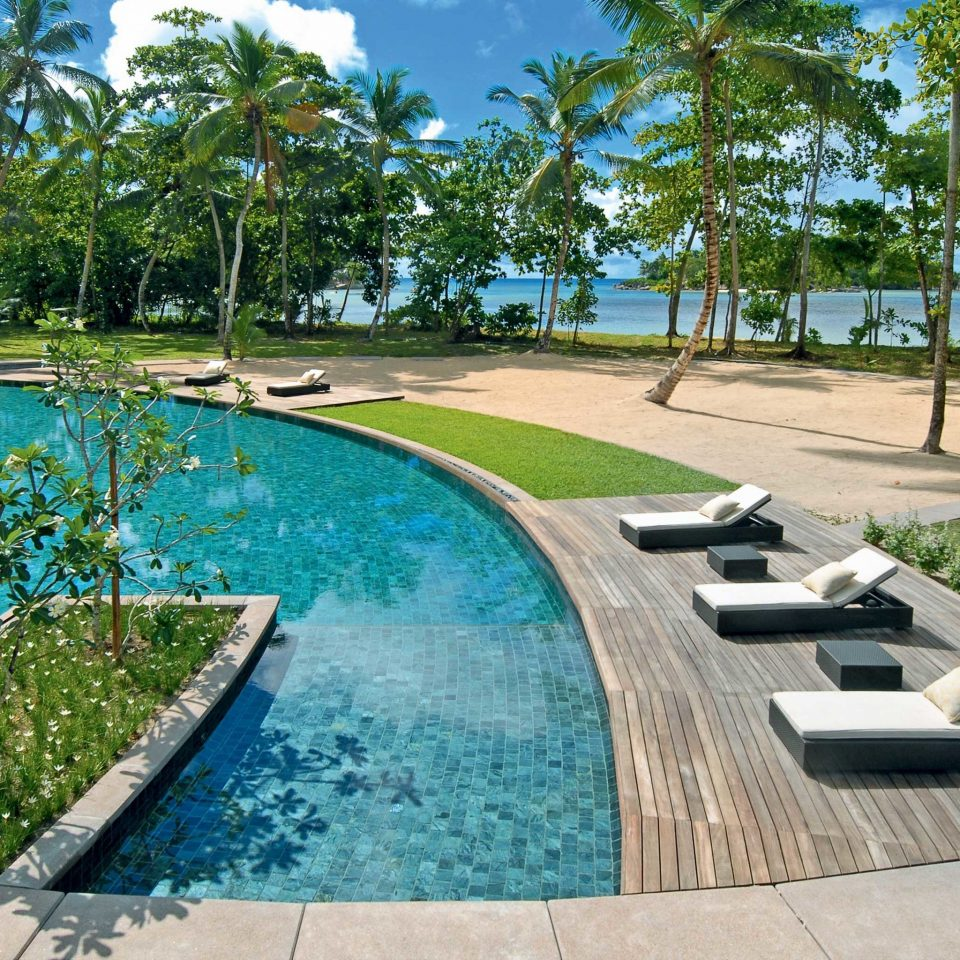 Beachfront Lounge Luxury Modern Pool tree sky ground swimming pool property leisure Resort condominium walkway park reflecting pool backyard Villa home landscape architect mansion