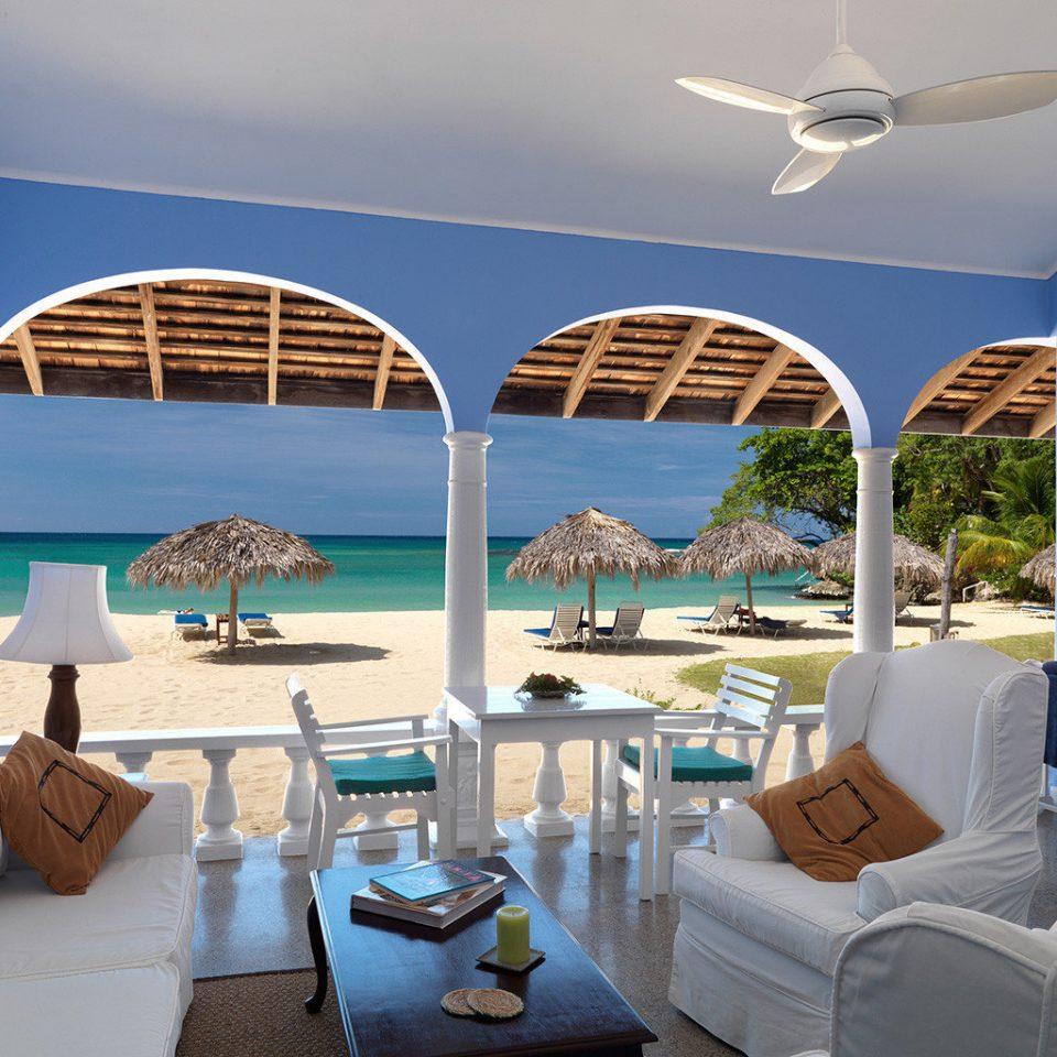 Beachfront Lounge Luxury Ocean Terrace property swimming pool home caribbean Resort condominium yacht Villa day