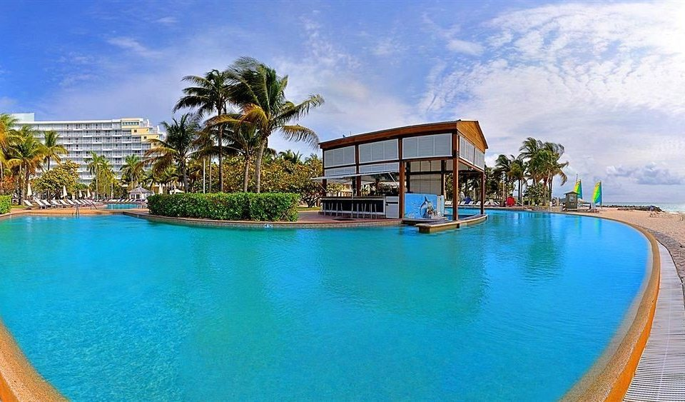 Beachfront Lounge Luxury Pool water sky Resort swimming pool property leisure condominium Villa caribbean resort town blue swimming Water park empty lined surrounded shore