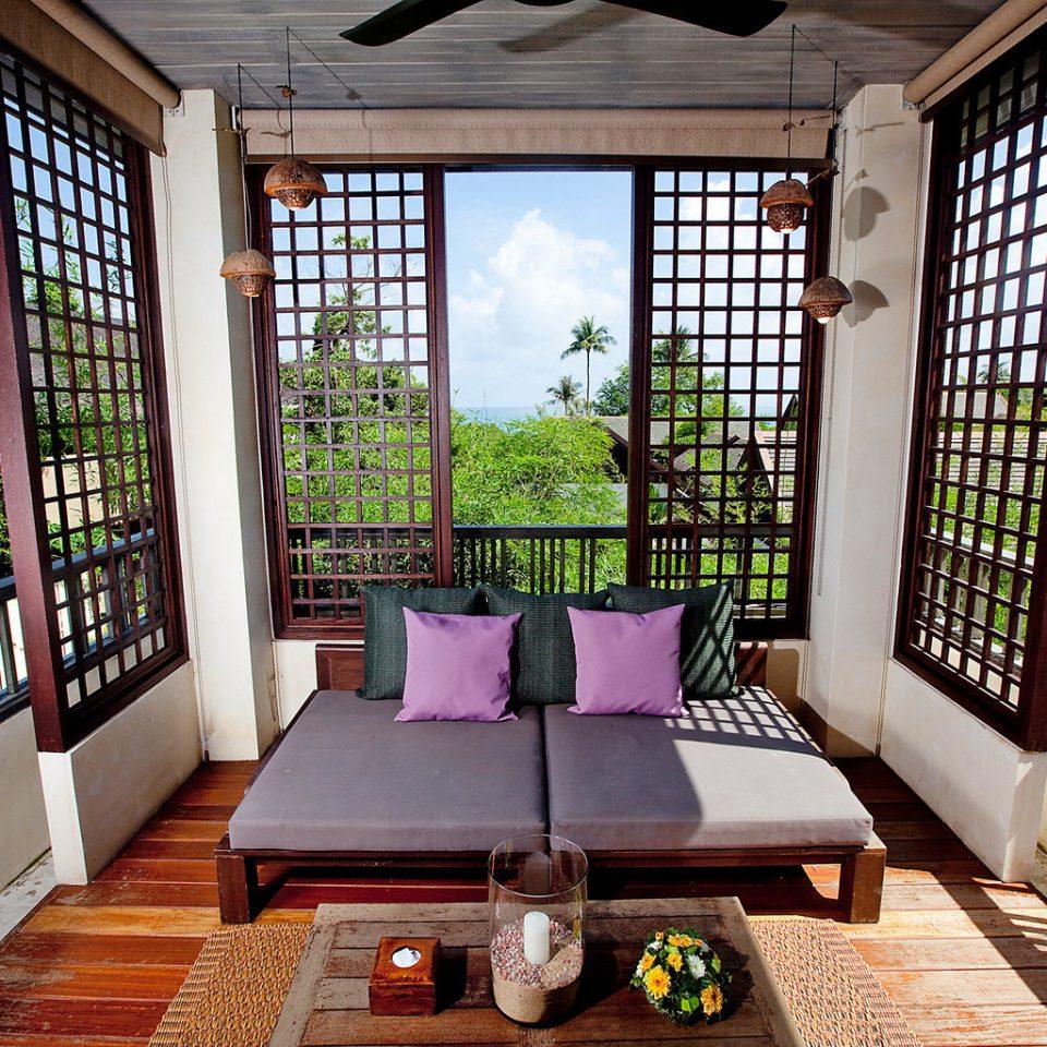 Beachfront Lounge Ocean Resort Tropical property porch house home Villa cottage outdoor structure living room condominium backyard farmhouse mansion