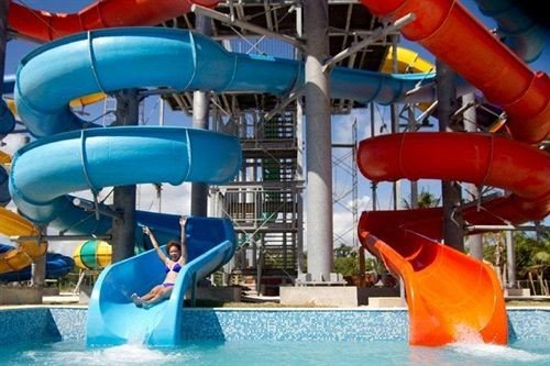 Beachfront Lounge Pool Tropical amusement park Water park park leisure blue outdoor recreation recreation Play playground slide inflatable nonbuilding structure orange