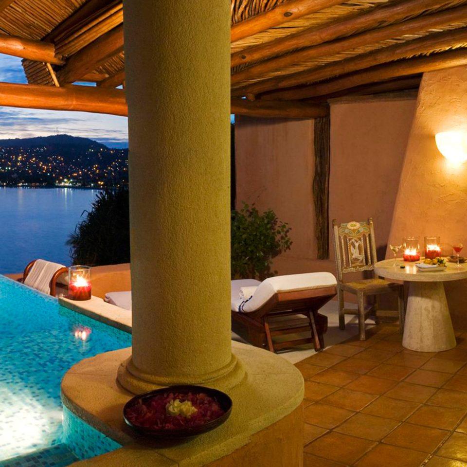 Beachfront Lounge Pool property swimming pool Resort Villa cottage mansion