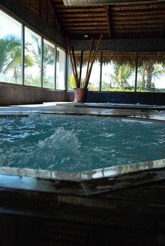 Beachfront Lounge Pool Tropical swimming pool property jacuzzi Resort bathtub