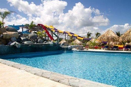 Beachfront Lounge Pool Tropical sky water amusement park Water park swimming pool leisure Resort park resort town recreation shore day