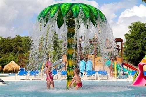 Beachfront Lounge Pool Tropical tree amusement park Water park leisure park outdoor recreation recreation Resort nonbuilding structure