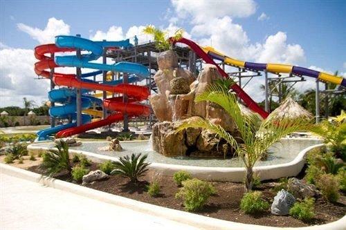 Beachfront Lounge Pool Tropical sky amusement park Water park park leisure recreation outdoor recreation nonbuilding structure Resort