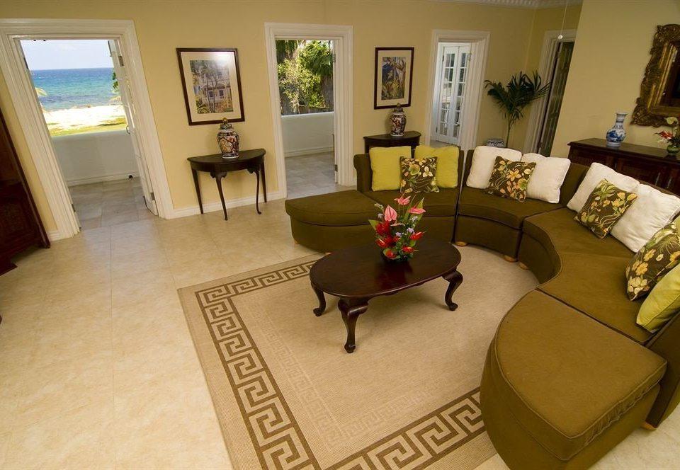 Beachfront Lounge Tropical Villa property living room home condominium Suite rug flooring cottage