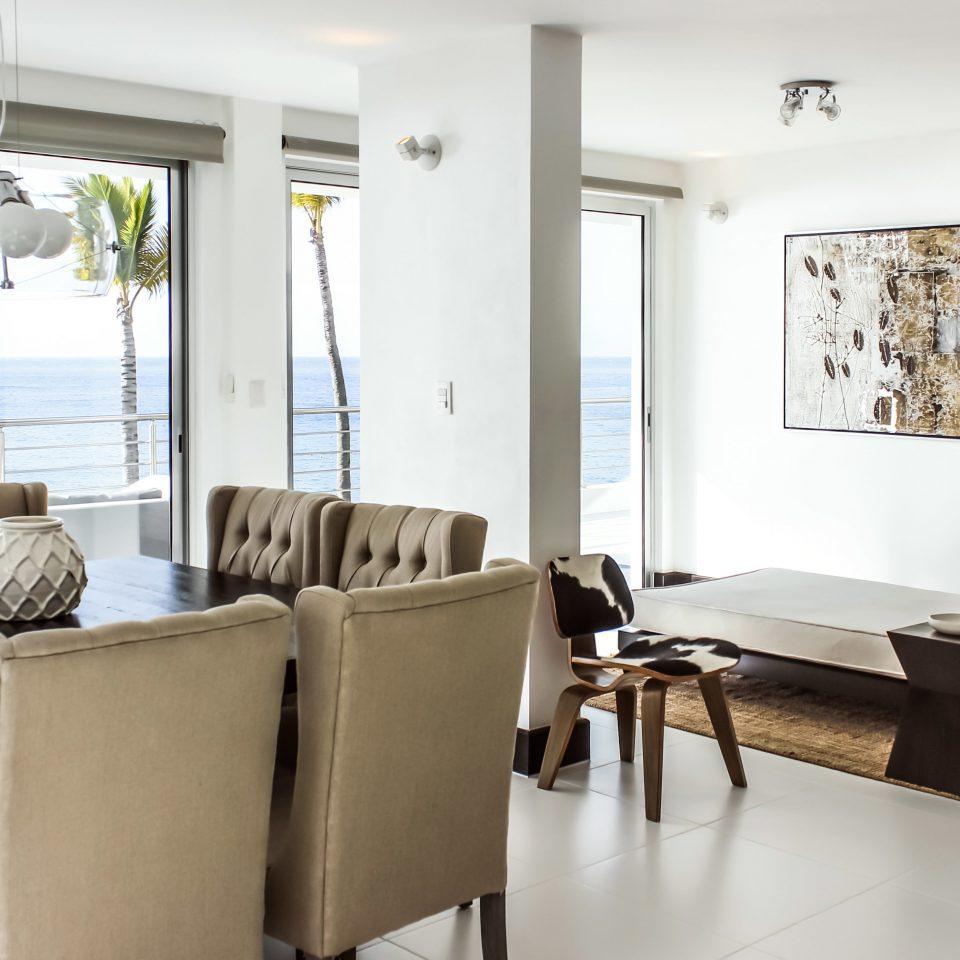 Beachfront Luxury Modern Suite sofa property chair living room condominium home nice waiting room flat