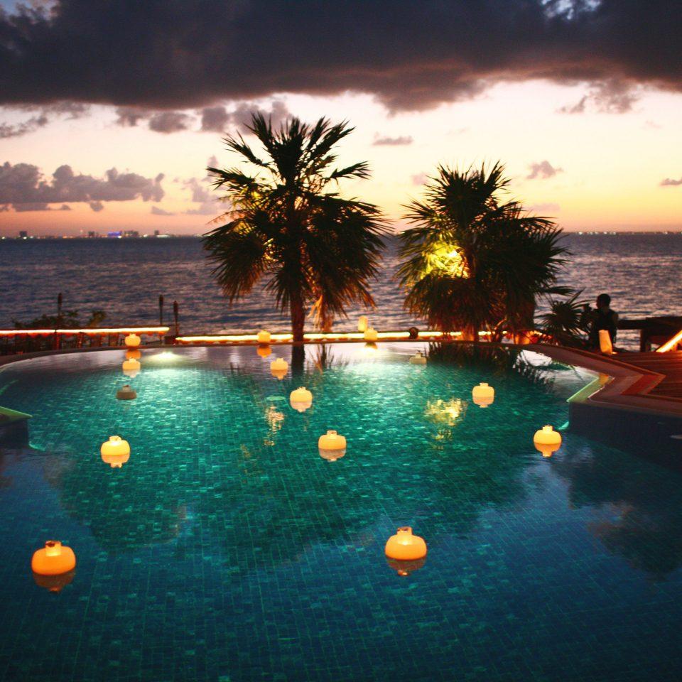 Beachfront Luxury Ocean Pool Sunset Waterfront water sky swimming pool Sun Sea evening Resort setting dusk set shore