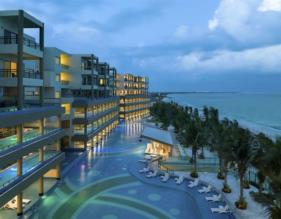 Beachfront Luxury Pool Resort Waterfront sky swimming pool condominium Sea marina waterway cityscape