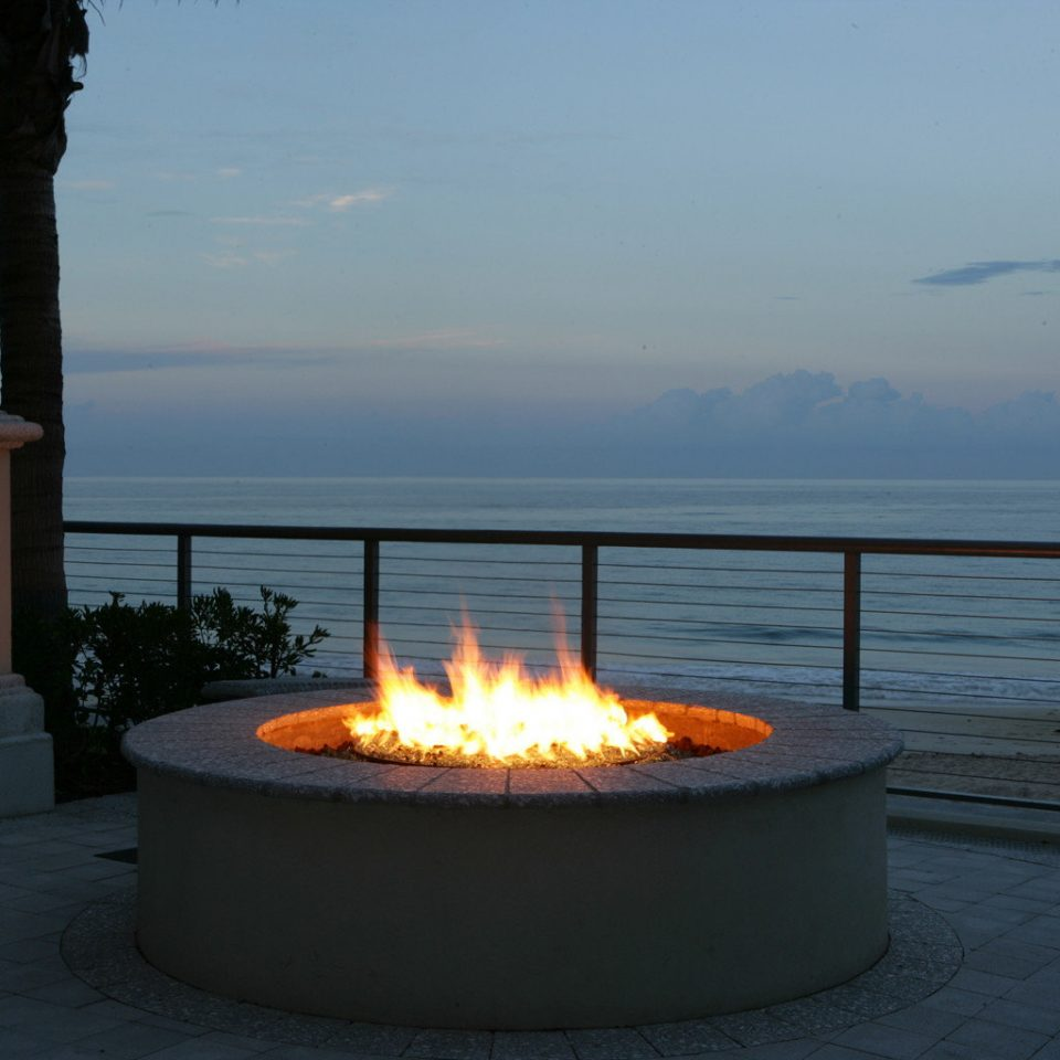 Beachfront Sunset water sky hearth lighting overlooking Ocean