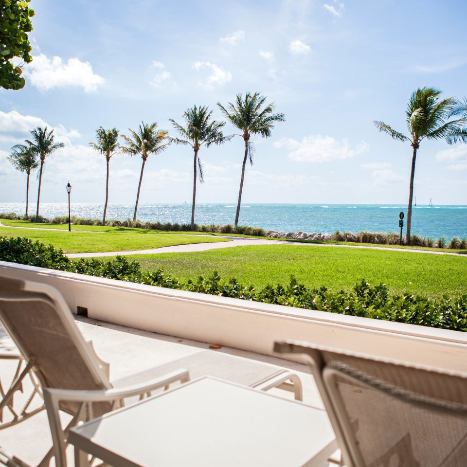 Beachfront Outdoors Patio Scenic views sky tree grass property house home Villa Resort condominium caribbean swimming pool mansion